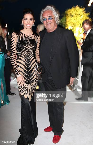 Flavio Briatore and his wife Elisabetta Gregoraci attend the Porsche At De Grisogono 'Fatale In Cannes' Party during the 67th Cannes Film Festival on...