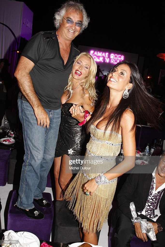 Flavio Briatore with <a gi-track='captionPersonalityLinkClicked' href=/galleries/search?phrase=Elisabetta+Gregoraci&family=editorial&specificpeople=606805 ng-click='$event.stopPropagation()'>Elisabetta Gregoraci</a> and Valeria Marini attend the Fawaz Gruosi birthday party at the Billionaire on August 8, 2007 in Porto Cervo, Italy.