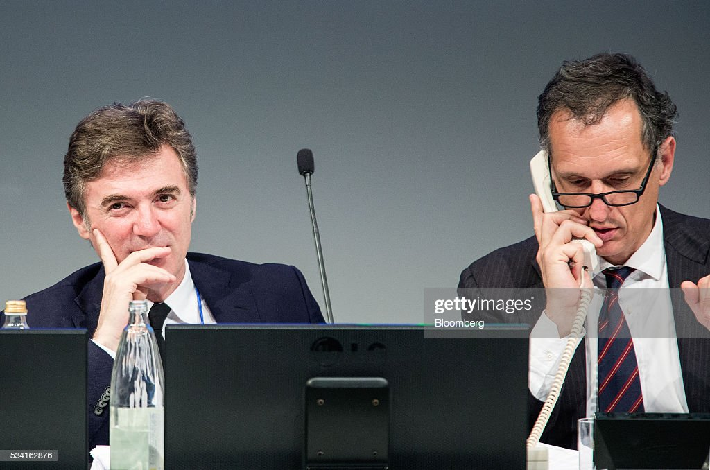 Flavio Cattaneo, chief executive officer of Telecom Italia SpA, left, looks on as with Giuseppe Recchi, chairman of Telecom Italia SpA, talks on a fixed line telephone during the company's annual general meeting (AGM) at their headquarters in Rozzano, near Milan, Italy, on Wednesday May 25, 2016. Telecom Italia named Cattaneo as CEO in March, turning to a media industry veteran to implement a turnaround. Photographer: Alessia Pierdomenico/Bloomberg via Getty Images