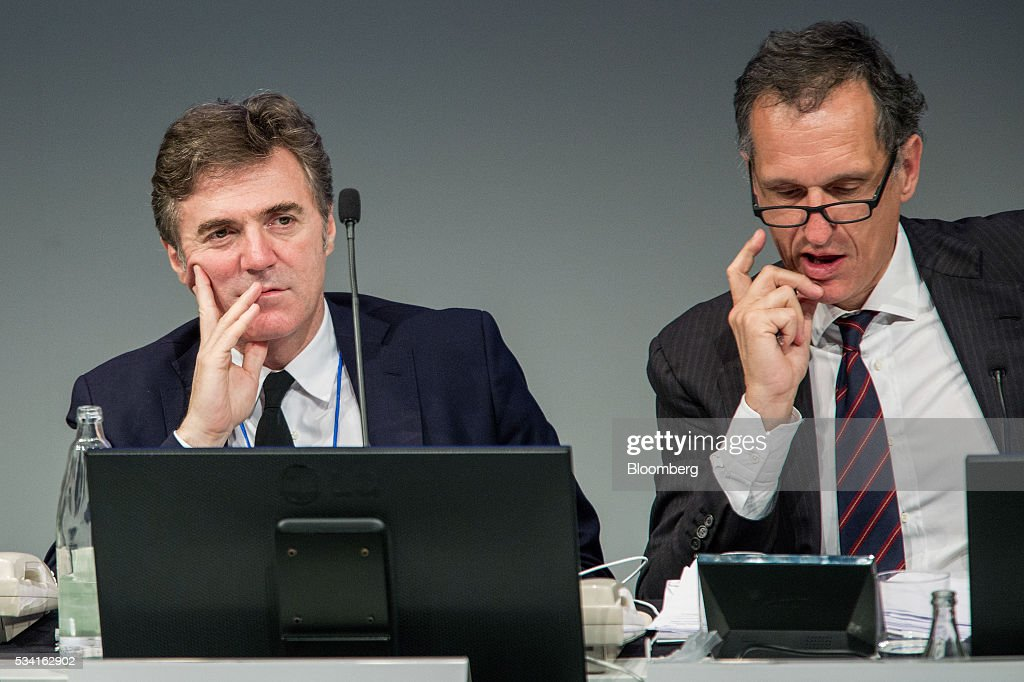 Flavio Cattaneo, chief executive officer of Telecom Italia SpA, left, sits with Giuseppe Recchi, chairman of Telecom Italia SpA, during the company's annual general meeting (AGM) at their headquarters in Rozzano, near Milan, Italy, on Wednesday May 25, 2016. Telecom Italia named Cattaneo as CEO in March, turning to a media industry veteran to implement a turnaround. Photographer: Alessia Pierdomenico/Bloomberg via Getty Images