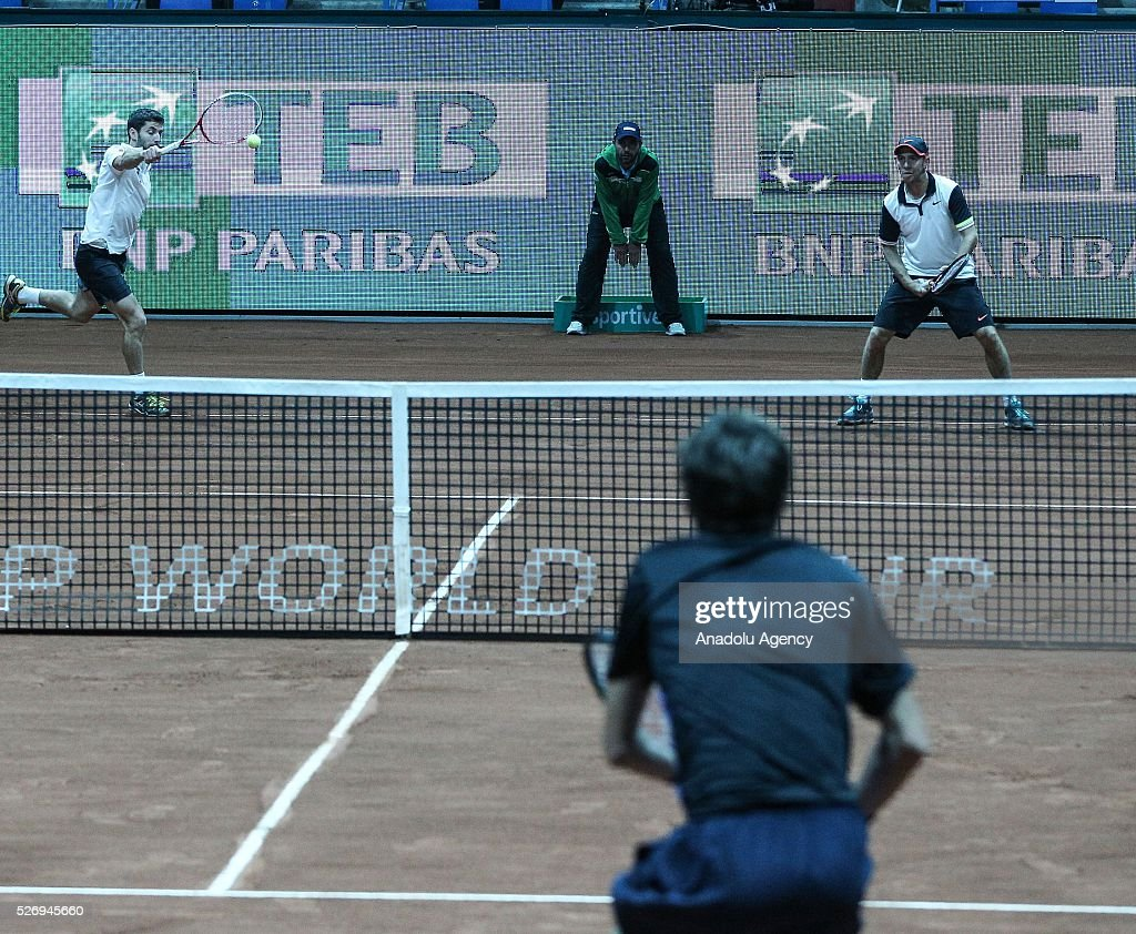 Flavio Cipolla (rear L) of Italy and Dudi Sela (rear R) of Israel Diego in action against Andres Molteni (R) and Diego Schwartzan (not seen) of Argentina during the men's double match at the TEB BNP Paribas Istanbul Open tennis tournament at Koza World of Sports Arena in Istanbul, Turkey on May 01, 2016.