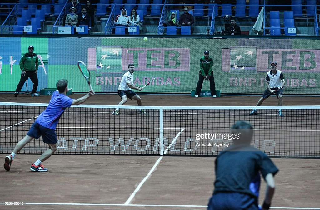 Flavio Cipolla (rear L) of Italy and Dudi Sela (rear R) of Israel in action against Andres Molteni (R) and Diego Schwartzan (L) of Argentina during the men's double match at the TEB BNP Paribas Istanbul Open tennis tournament at Koza World of Sports Arena in Istanbul, Turkey on May 01, 2016.