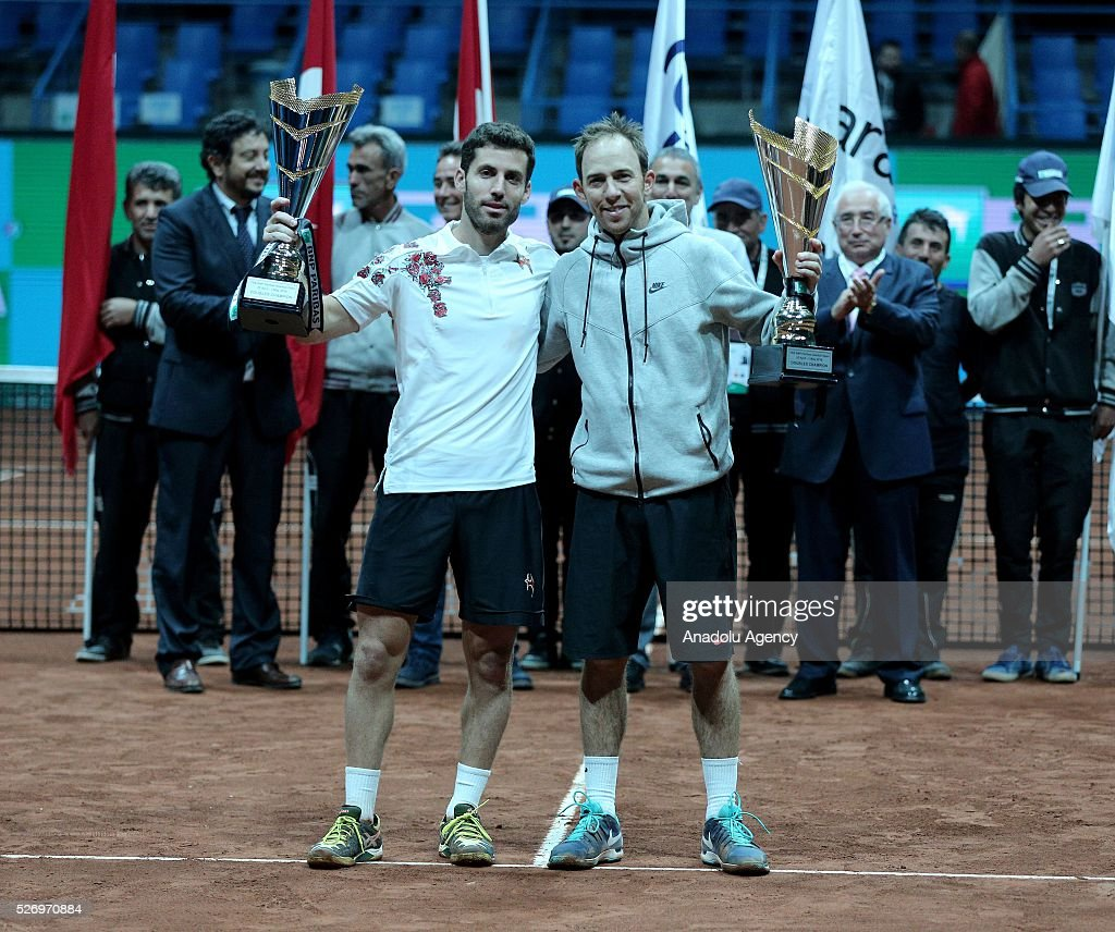 Flavio Cipolla (L) of Italy and Dudi Sela (R) of Israel pose for a photograph with their trophies at the end of the men's double match at the TEB BNP Paribas Istanbul Open tennis tournament at Koza World of Sports Arena in Istanbul, Turkey on May 01, 2016.