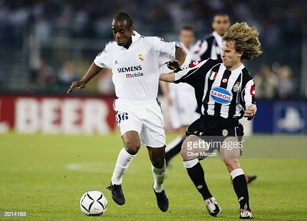 Flavio Conceicao of Real Madrid is tackled by Pavel Nedved of Juventus during the UEFA Champions League semi final second leg match between Juventus...