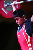 Flavio Lahuanampa of Peru B competes in the Men's 56kg snatch during day one of the 2013 Junior Weightlifting World Championship at Maria Angola...