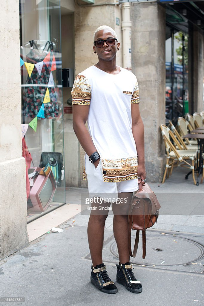 Flavio Semido Gabral wearing a Black Caviar top, Giuseppe Zanotti shoes, H and M sunglasses and a vintage bag on day 2 of Paris Collections: Men on June 26, 2014 in Paris, France.