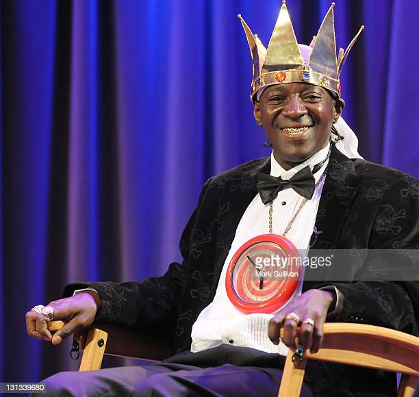 Flavor Flav gestures onstage during An Evening With Flavor Flav at The GRAMMY Museum on June 1 2011 in Los Angeles California