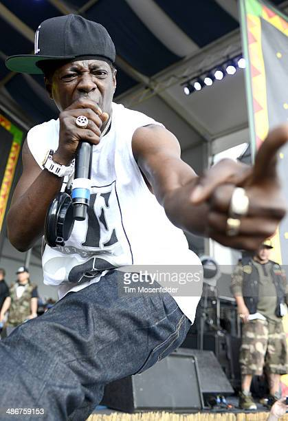 Flavor Flav of Public Enemy performs during the 2014 New Orleans Jazz Heritage Festival at Fair Grounds Race Course on April 25 2014 in New Orleans...