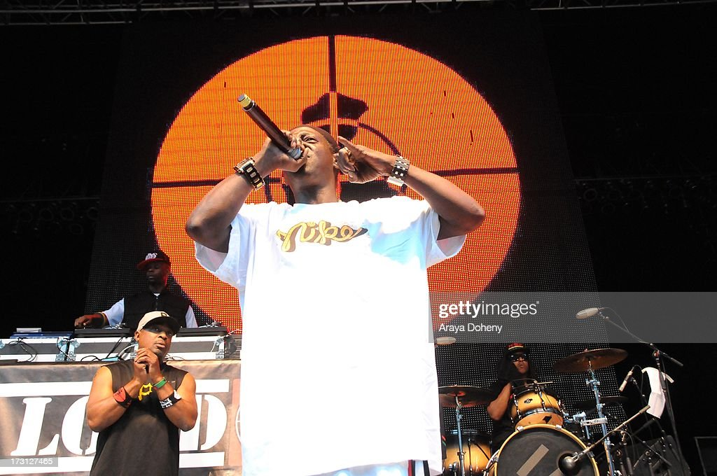 Flavor Flav of Public Enemy performs on stage at the Kings of the Mic Tour with special guests LL Cool J, Ice Cube, Public Enemy and De La Soul at The Greek Theatre on July 7, 2013 in Los Angeles, California.