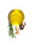 Flavoring: olive oil, garlic, pepper and rosemary isolated on white background