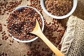 flax seed in a jute bag - grain-linseed-healthy-seed