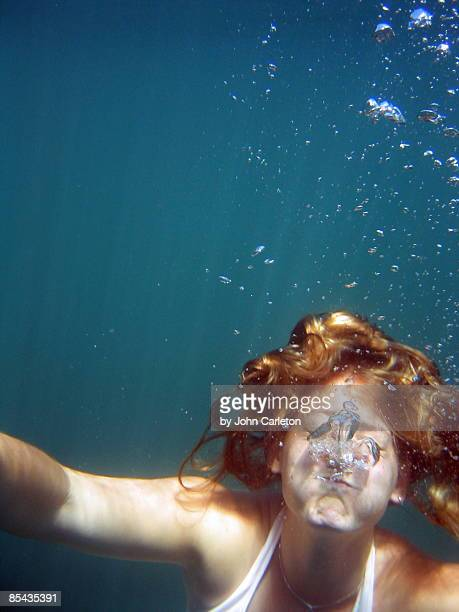 Flaxen-haired girl underwater