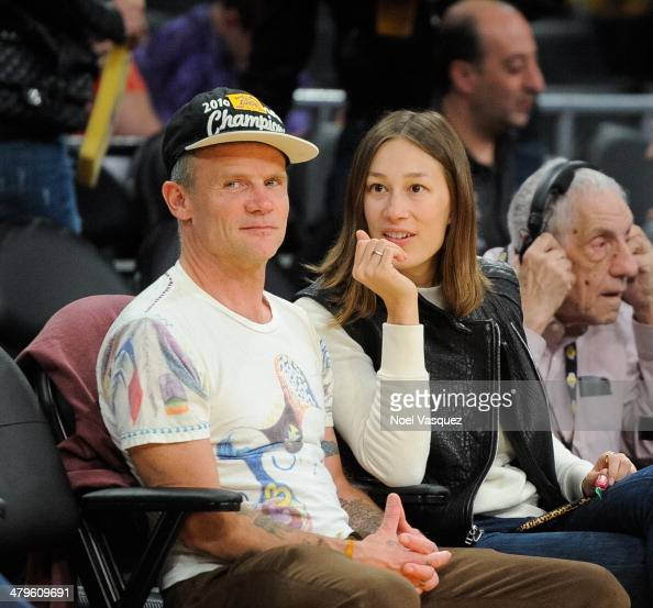 Flea attends a basketball game between the San Antonio Spurs and the Los Angeles Lakers at Staples Center on March 19 2014 in Los Angeles California