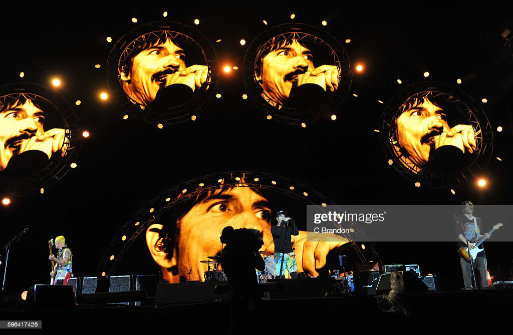 Flea, Chad Smith, Anthony Kiedis and Josh Klinghoffer of Red Hot Chili Peppers headline on the Main Stage during Day 2 of the Reading Festival at Richfield Avenue on August 27, 2016 in Reading, England.