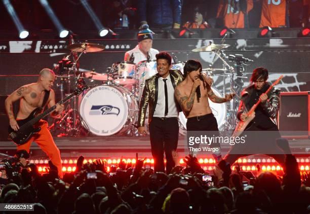 Flea Chad Smith Bruno Mars Anthony Kiedis and Josh Klinghoffer perform during the Pepsi Super Bowl XLVIII Halftime Show at MetLife Stadium on...