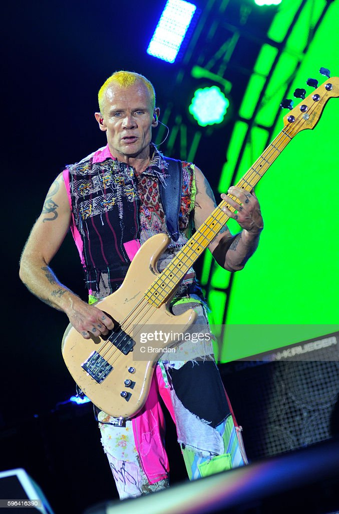 Flea of Red Hot Chili Peppers headlines on the Main Stage during Day 2 of the Reading Festival at Richfield Avenue on August 27, 2016 in Reading, England.