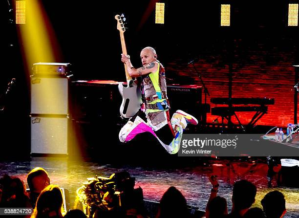 Flea of Red Hot Chili Peppers performs onstage during their album release party on ATT LIVE at iHeartRadio Theater on May 26 2016 in Burbank...
