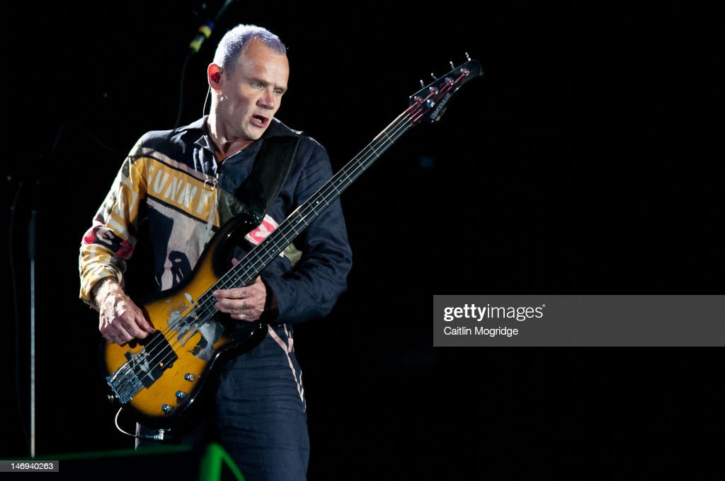 Flea of Red Hot Chilli Peppers performs on stage at Knebworth House on June 23 2012 in Stevenage United Kingdom