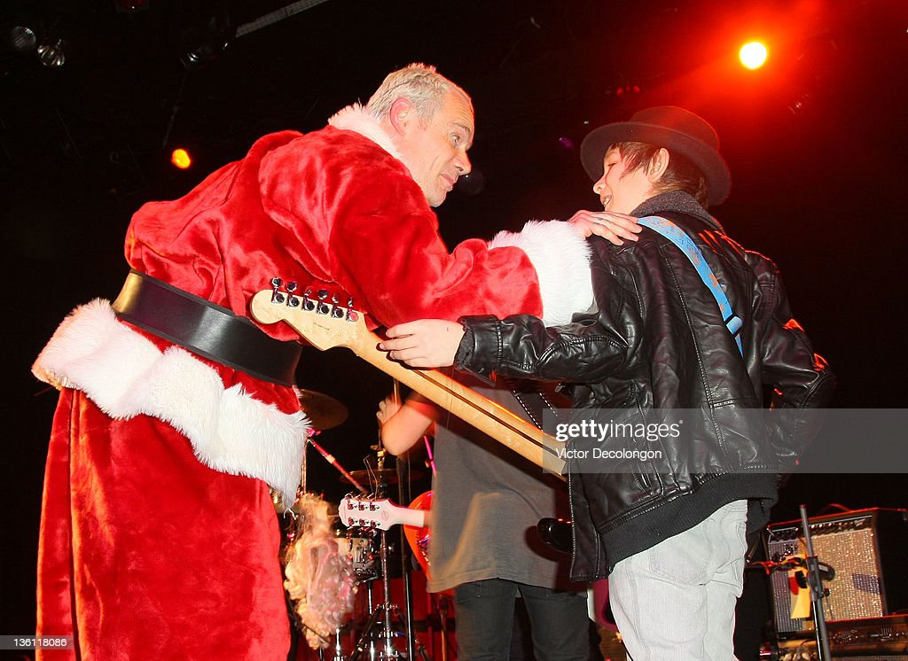 <a gi-track='captionPersonalityLinkClicked' href=/galleries/search?phrase=Flea+-+Musician&family=editorial&specificpeople=213900 ng-click='$event.stopPropagation()'>Flea</a> of the Red Hot Chili Peppers encourages Jimmy (R) of Live Wire after their performance at the Silverlake Conservatory Of Music's 'Hullabaloo' Benefit Concert at El Rey Theatre on December 22, 2011 in Los Angeles, California.