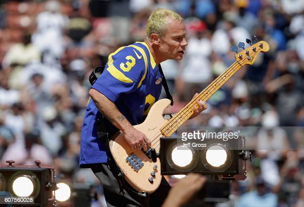 Flea of the Red Hot Chili Peppers performs before the Los Angeles Rams home opening NFL game against the Seattle Seahawks at Los Angeles Coliseum on...