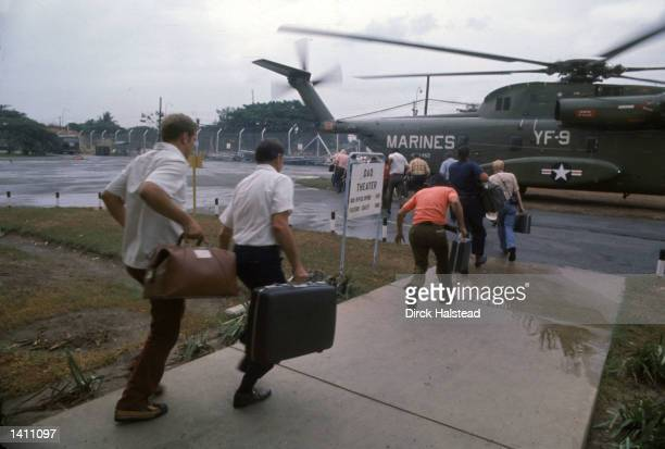 Fleeing Americans board a US Marine helicopter at Tan Son Nhut Airbase in Saigon April 1975 American involvement in the Vietnam War came to an end...