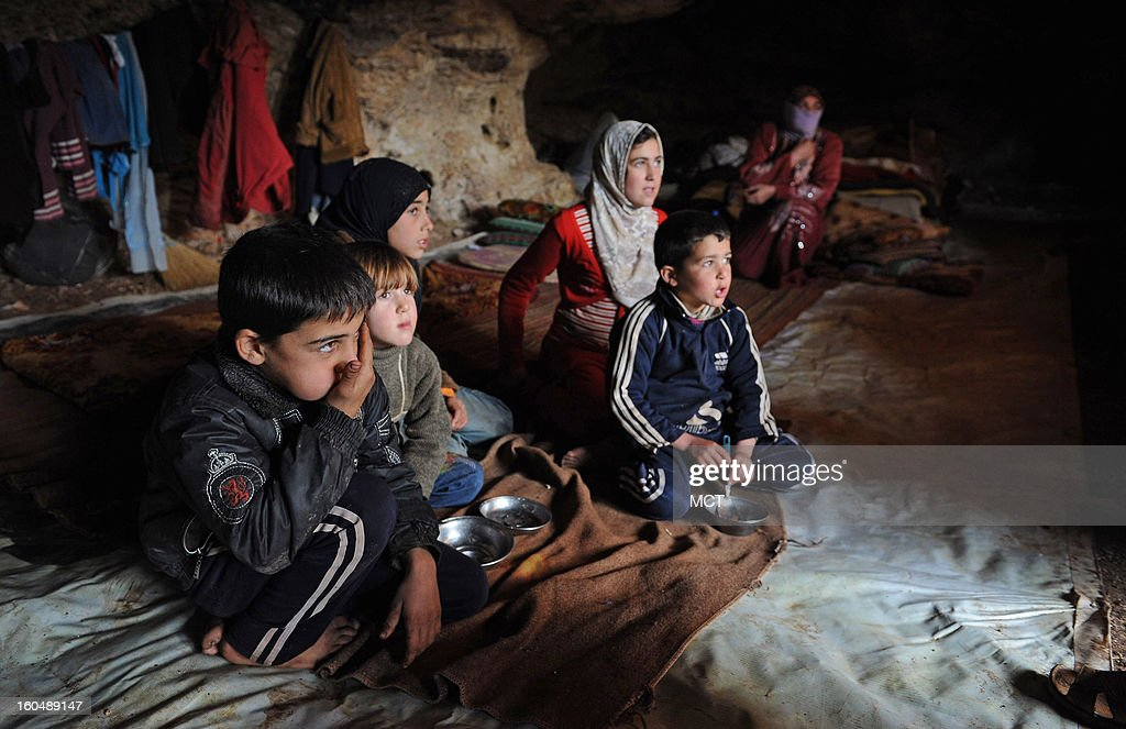 Fleeing bombardment of their village by Syria's Assad regime, 'Um Ali,' 38, as the mother of six children asked to be called, sits in the back of the cave they have found as their own shelter. The cave, just outside the village of al Sahriah, measures about 12 by 35 feet.