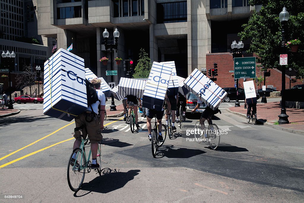 A fleet of bicycle messengers carry very large packages near City Hall on June 30, 2016 in Boston, Massachusetts.