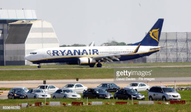 A fleet of cars awaits the England players when they arrive at at Stansted Airport Essex Picture date Sunday July 2 2006 England lost 31 in a penalty...