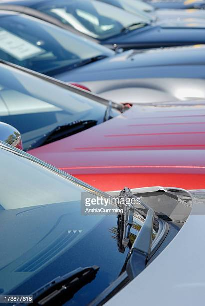 Fleet of Cars parked side by side in car park