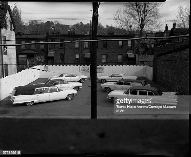 Fleet of hearses and limousines in Frederick Funeral Home in parking lot Pittsburgh Pennsylvania 1966