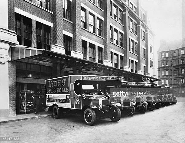 A fleet of Lyons delivery vans Cadby Hall West Kensington London Being loaded up with their deliveries Cadby Hall was Lyons' headquarters and factory...