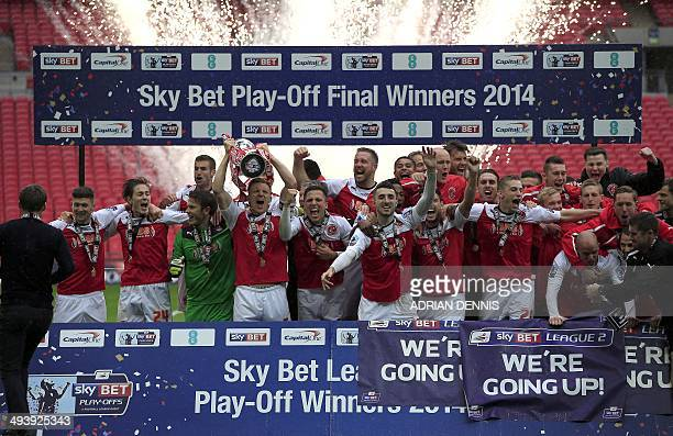 Fleetwood Town players celebrate with the trophy after winning the English League 2 PlayOff final football match against Burton Albion at Wembley...