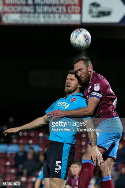 Fleetwood Town's Ashley Eastham competing in the air with Scunthorpe United's Rory McArdle during the Sky Bet League One match between Scunthorpe...