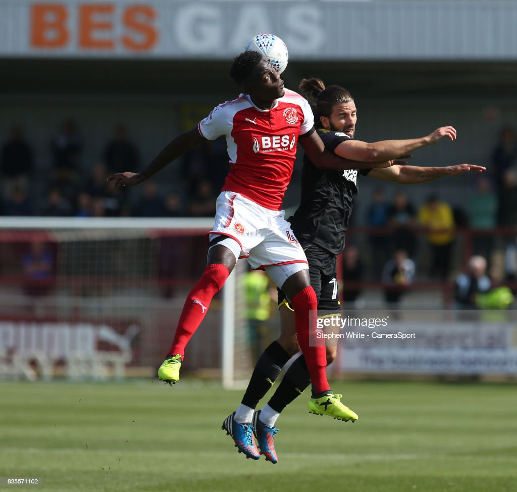 Fleetwood Town's Devante Cole and AFC Wimbledon's George Francomb during the Sky Bet League One match between Fleetwood Town and A.F.C. Wimbledon at Highbury Stadium on August 19, 2017 in Fleetwood, England.