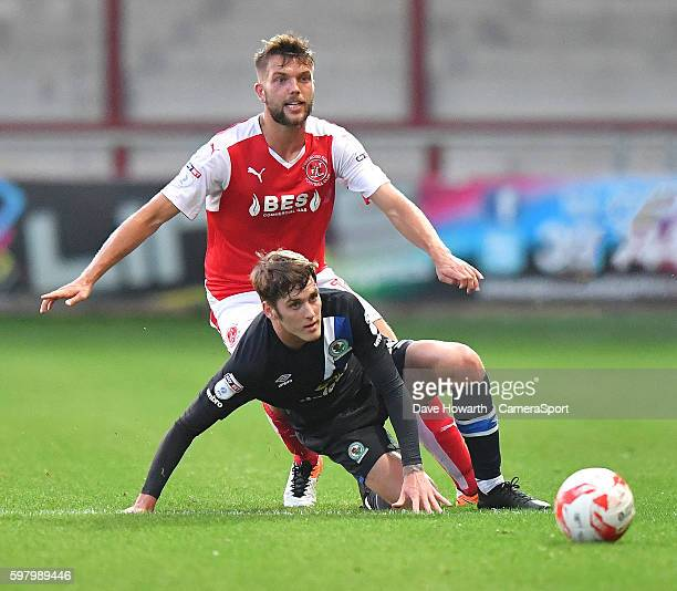 Fleetwood Town's Joe Davis battles with Blackburn Rovers' Connor Mahoney during the EFL Checkatrade Trophy match between Fleetwood Town and Blackburn...