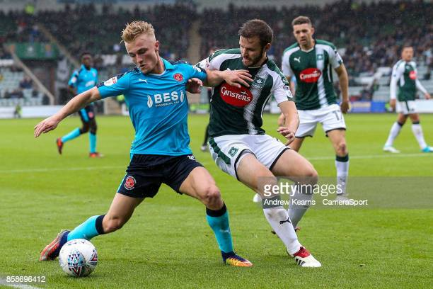 Fleetwood Town's Kyle Dempsey competing with Plymouth Argyle's Jamie Ness during the Sky Bet League One match between Plymouth Argyle and Fleetwood...