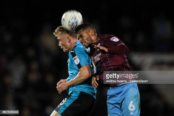 Fleetwood Town's Kyle Dempsey competing with Scunthorpe United's Funso Ojo in the air during the Sky Bet League One match between Scunthorpe United...
