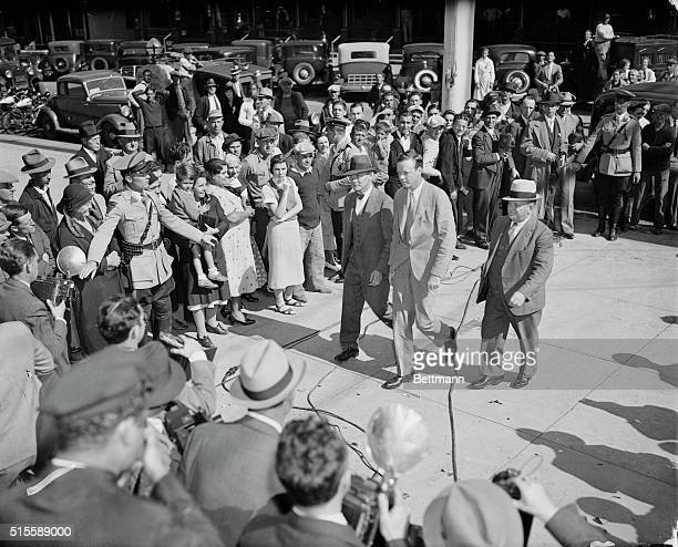 Col Lindbergh Appears Before Grand Jury Police restrain crowds as Col Charles Lindbergh flanked by Col Norman Schwartzkopf head of the New Jersey...