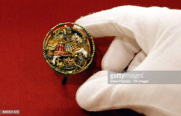 A Flemish hat badge showing St George and the dragon c1520 is carefully checked as the final preparations are put in place for the Henry VIII A 500th...