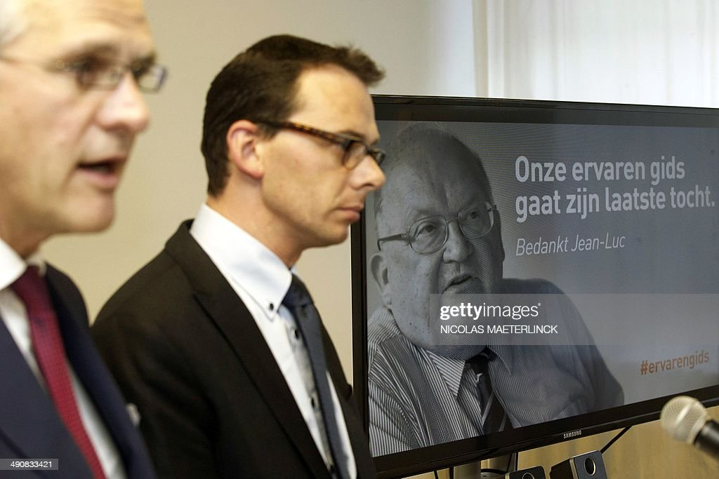 Flemish Minister President Kris Peeters (L) and Flemish Socal-Democrat CD&V party Chairman Wouter Beke give a press conference on the death of Belgium state minister <a gi-track='captionPersonalityLinkClicked' href=/galleries/search?phrase=Jean-Luc+Dehaene&family=editorial&specificpeople=2586798 ng-click='$event.stopPropagation()'>Jean-Luc Dehaene</a> (on screen in the background) at the age of 73 years old, on May 15, 2014 in Brussels. Dehaene, a former Belgian Prime Minister and chairman of the Dexia bank, passed away in France today during a visit to Brittany, due to a fall, according to a statement by the CD&V party. AFP PHOTO / BELGA / NICOLAS MAETERLINCK **Belgium Out**