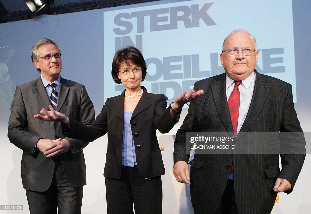 Flemish Minister President Kris Peeters, chairwoman Marianne Thyssen and former Prime Minister <a gi-track='captionPersonalityLinkClicked' href=/galleries/search?phrase=Jean-Luc+Dehaene&family=editorial&specificpeople=2586798 ng-click='$event.stopPropagation()'>Jean-Luc Dehaene</a> are pictured at a national elections congress of CD&V on the theme 'Strong in difficult times', for upcoming regional and European elections in June, on April 25, 2009, in Gent.