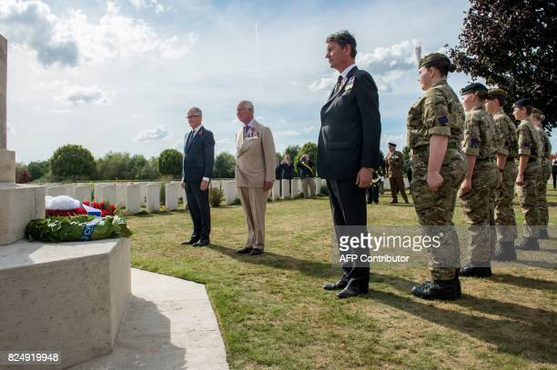 Flemish MinisterPresident Geert Bourgeois Britain's Prince Charles and Vice Admiral Sir Timothy Laurence stand after laying a wreath during a...