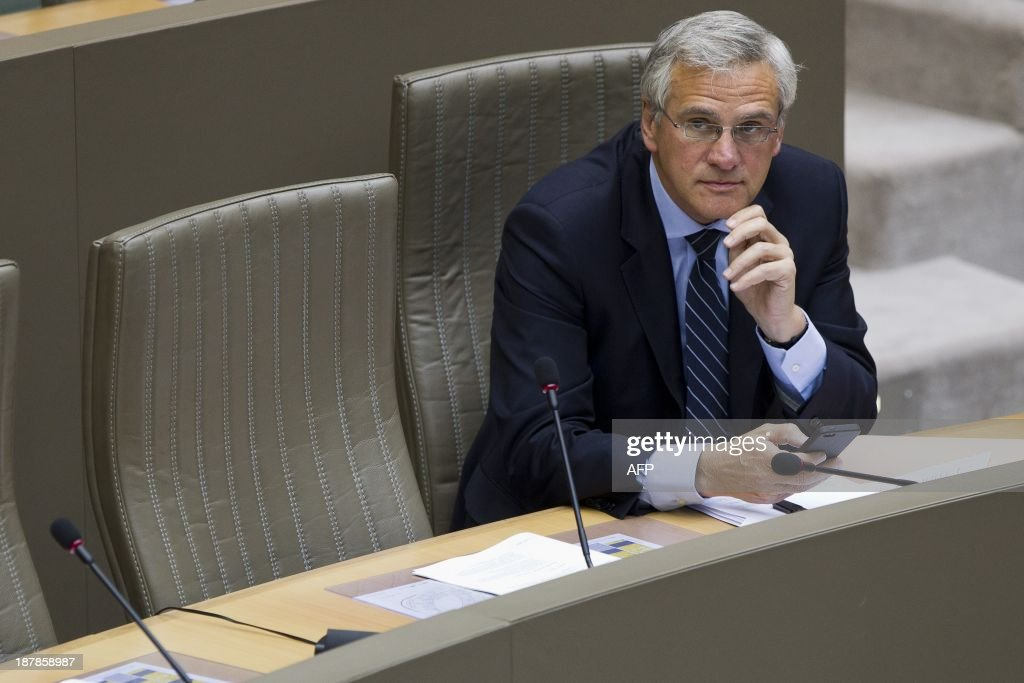 Flemish Minister-President of the Christian Democratic and Flemish (CD&V) party Kris Peeters attends a plenary session of the Flemish Parliament in Brussels on November 13, 2013. AFP PHOTO / BELGA / KRISTOF VAN ACCOM **BELGIUM OUT**