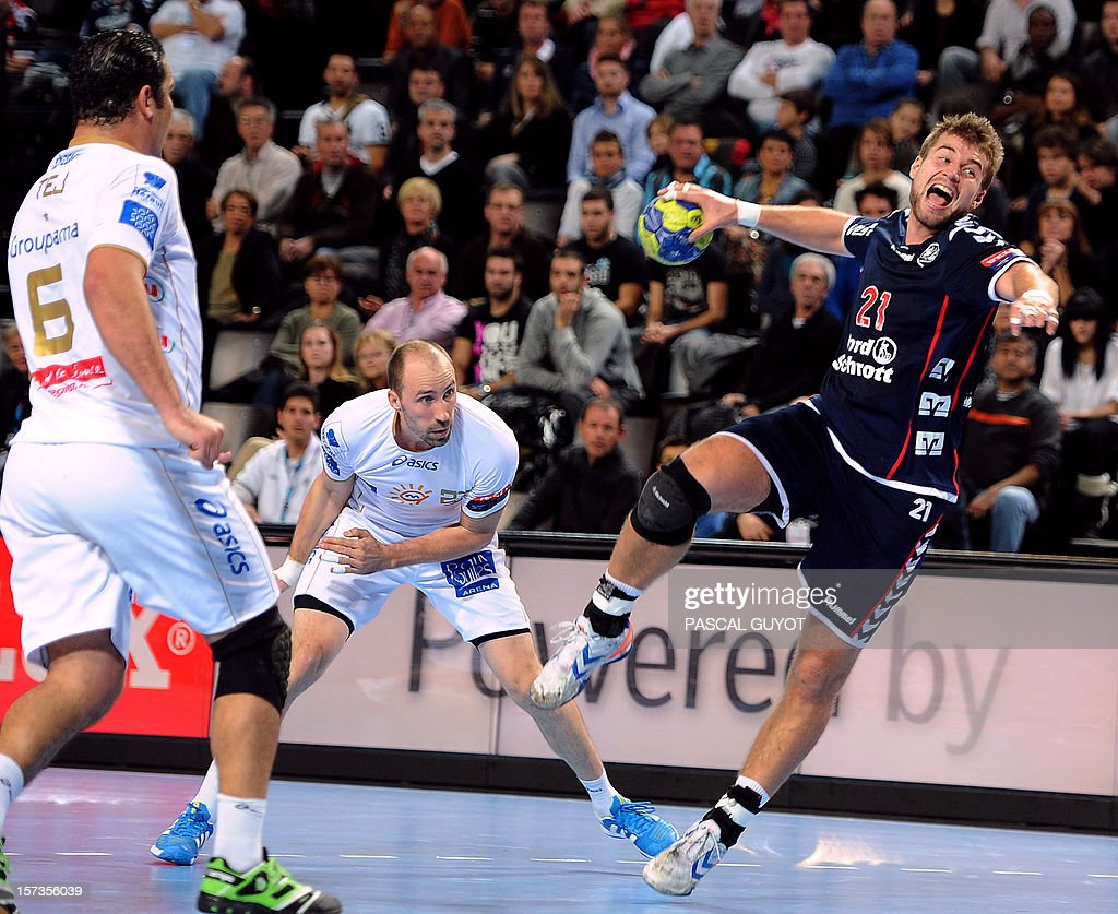Flensburg's Jacob Heinl (R) takes a shot during the Champions League handball match Montpellier AHB vs SG Flensburg-Handewitt, on December 2, 2012 at the Arena hall in Montpellier, southern France.