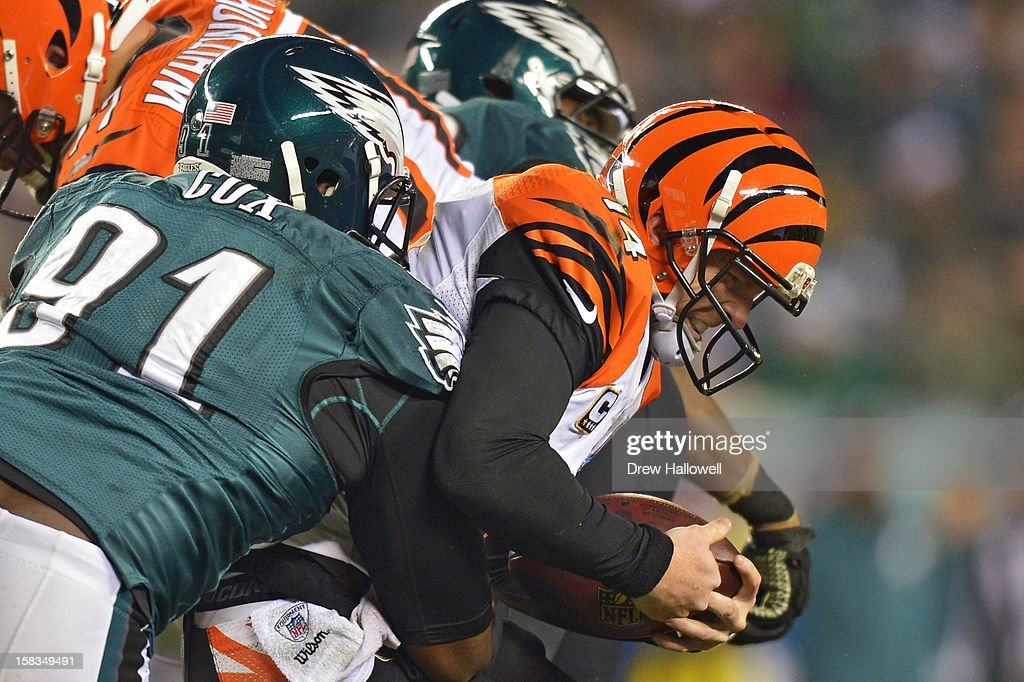 Fletcher Cox #91 of the Philadelphia Eagles sacks <a gi-track='captionPersonalityLinkClicked' href=/galleries/search?phrase=Andy+Dalton+-+American+Football+Player&family=editorial&specificpeople=15271549 ng-click='$event.stopPropagation()'>Andy Dalton</a> #14 of the Cincinnati Bengals at Lincoln Financial Field on December 13, 2012 in Philadelphia, Pennsylvania. The Bengals won 34-13.