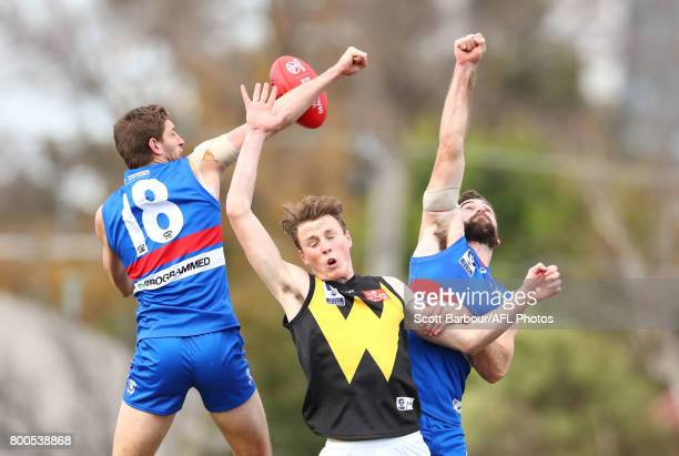 Fletcher Roberts of Footscray Kieran Collins of Footscray and Nick Larkey of Werribee compete for the ball during the 2017 VFL round 10 match between...