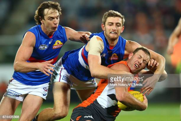Fletcher Roberts of the Bulldogs tackles Steve Johnson of the Giants during the round six AFL match between the Greater Western Sydney Giants and the...