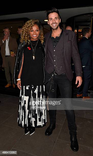 Fleur East and Ben Haenow leaves Grosvenor Hotel after the Music Industry Trusts Awards on November 2 2015 in London England