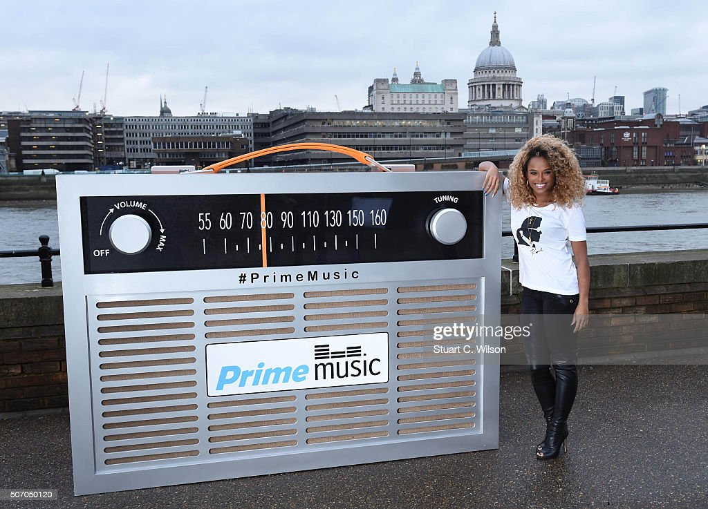 Fleur East poses with a giant transistor radio in front of St. Paul's Cathedral to celebrate the launch of Prime Stations on Amazon's Prime Music streaming service, which will enable Prime members unlimited ad-free access to hundreds of personalised internet radio stations and to follow song lyrics as they listen on January 27, 2016 in London, England.