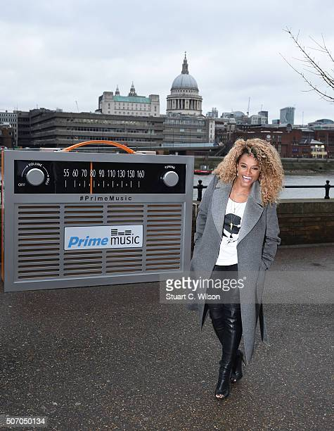 Fleur East poses with a giant transistor radio in front of St Paul's Cathedral to celebrate the launch of Prime Stations on Amazon's Prime Music...